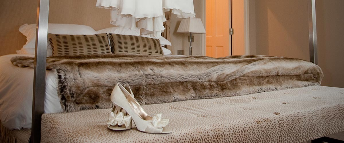 Wedding shoes on the bed at Bowood